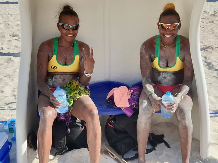 Miller Pata and Sherysyn Toko celebrate winning the Oceania Beach Volleyball Championship title.
