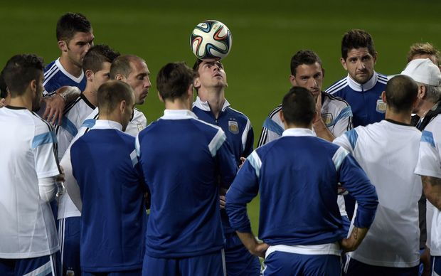 Argentina forward Lionel Messi, centre, with the team at a training session.