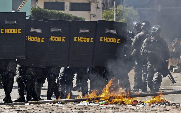 Riot police broke up protests in Sao Paolo.