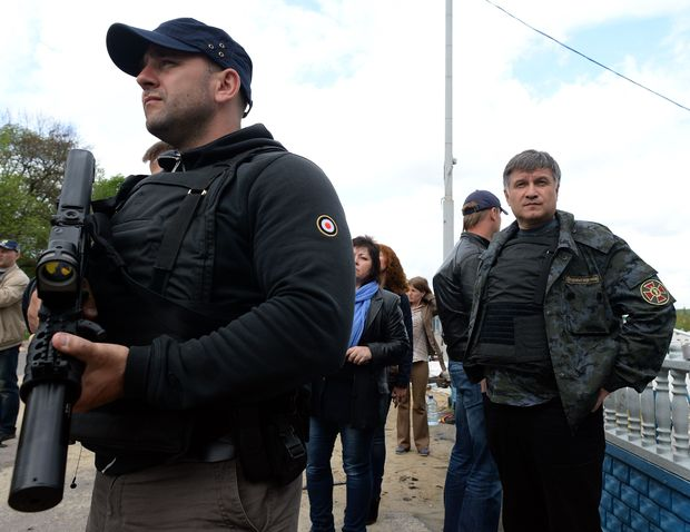 Ukrainian interior minister Arsen Avakov, right, looks on as he visits a checkpoint near the eastern Ukranian city of Slavyansk, May 2014.