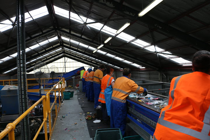 Employees sort through recycling material at the Wellington recycling facility at Seaview.