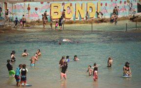 Sunbathers cool off on Bondi Beach as temperatures soar in Sydney