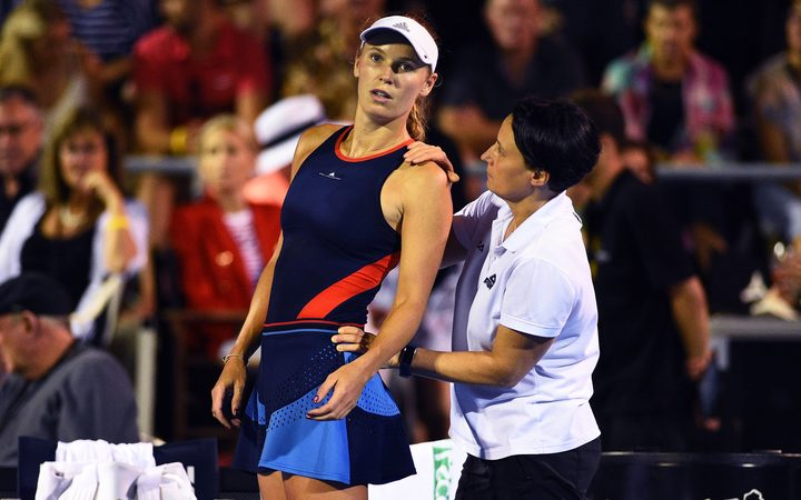 Caroline Wozniacki receives medical treatment during the ASB Classic.