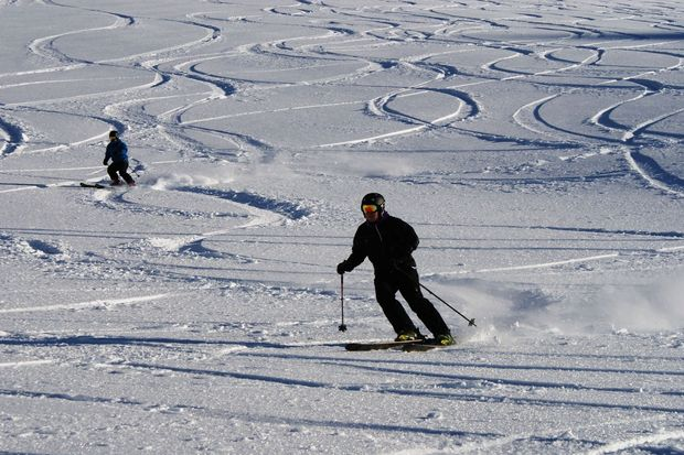 Skiers get in their first turns for the 2014 snow season at Mt Hutt.