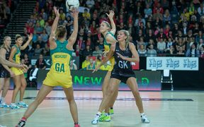Natalie Medhurst from Australia tries to pass to team mate Caitlin Bassett from Australia as Casey Kopua from New Zealand pressures her during the New Zealand Silver Ferns vs Australian Diamonds netball test match, the second game of the 2015 Constellation Cup.