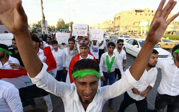 Iraqi men take part in a demonstration to show their support for the call to arms by Shiite cleric Grand Ayatollah Ali al-Sistani.