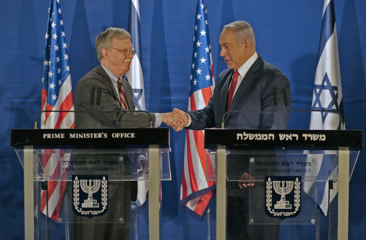 Israeli Prime Minister Benjamin Netanyahu and US National Security Advisor John Bolton shake hands during a joint statement to the media follow their meeting in Jerusalem