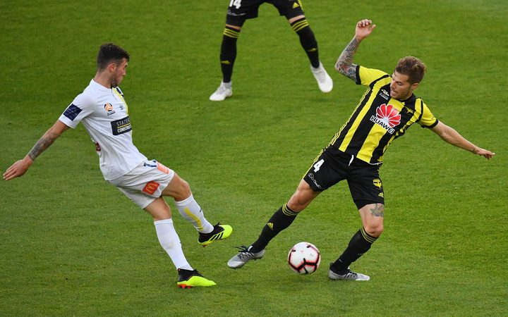 Phoenix player Mandi fights for possession against the Central Coast Mariners earlier this season.
