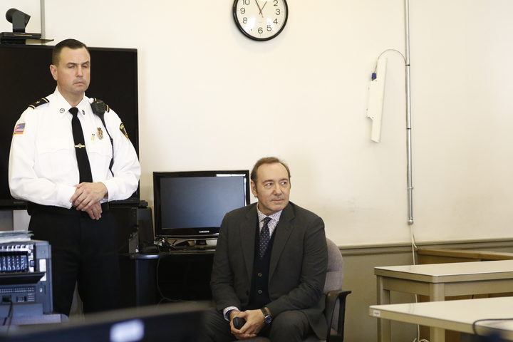 Kevin Spacey sits in chair while the legal teams meet during his arraignment at Nantucket District Court in Nantucket, Massachusetts on January 7, 2019.