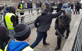"A video grab shows Christophe Dettinger fighting with riot police during a demonstration by ""Gilets Jaunes"" anti-government protestors."