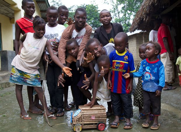 Boma children with a Karma Cola truck.