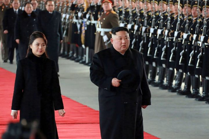 This picture taken on January 7, 2019 and released by North Korea's official Korean Central News Agency (KCNA) on January 8, 2019 shows North Korean leader Kim Jong Un (R) and his wife Ri Sol Ju leaving Pyongyang Station to visit China.  AFP.