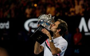 Roger Federer kisses his trophy after winning the Final in the 2018 Australian Open