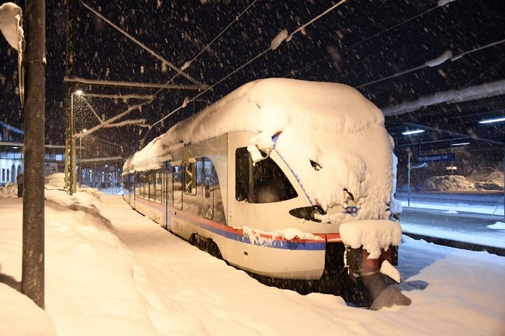 A commuter train  at the station of Berchtesgaden, southern Germany, on January 10, 2019, where rail transport stopped due to heavy snowfalls.