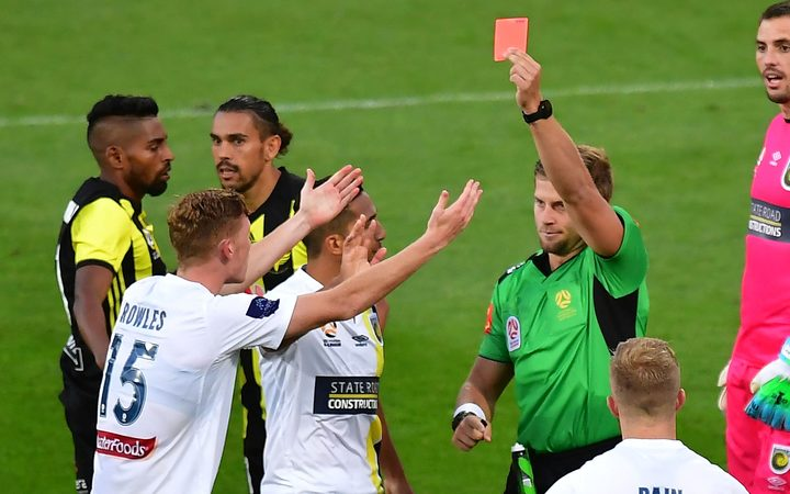 Mariners' Kye Rowles (L) is red carded during the A-League game against Phoenix.
