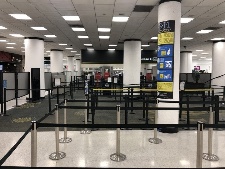 Terminal G security checkpoint of Miami International Airport is deserted on Saturday, January 12, 2019 after it was forced to shut down due to a shortage of security agents.