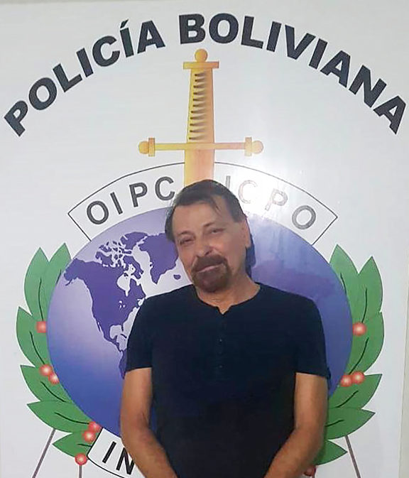 A handout picture taken by the Bolivian police forces and released on January 13, 2019 shows former far-left Italian militant Cesare Battisti after he was arrested late on January 12, 2019 in the Bolivian city of Santa Cruz de la Sierra.
