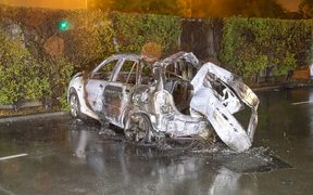 The remains of the car which burst into flames after a crash that claimed three lives, following a police pursuit in central Christchurch.