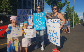 Esme and Frey Battson, 6 and 4, out in support of their junior doctor mum.