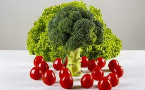 broccoli, green lettuce and cherry tomatoes on a table