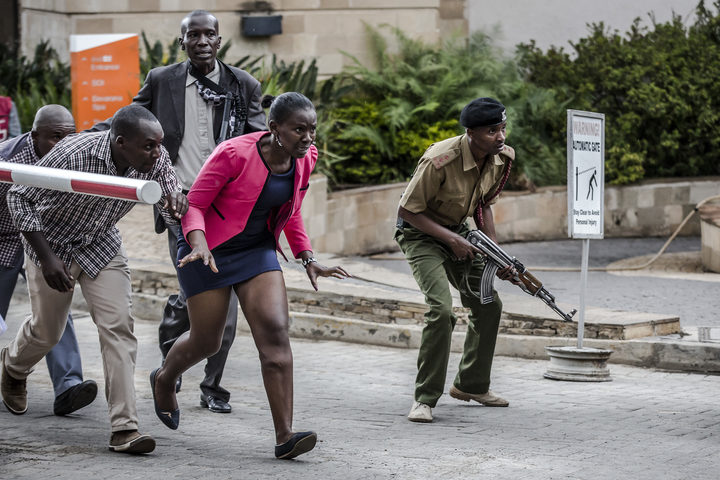 People leave the scene of an explosion at a hotel complex in Nairobi's Westlands suburb on January 15, 2019, in Kenya.