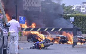 Burning cars at the scene of an explosion at a hotel complex in Nairobi on January 15, 2019.
