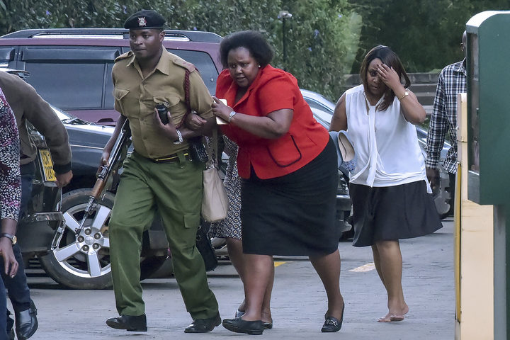 People are evacuated as a gunfight was underway following a blast at a hotel and office complex in Nairobi on January 15, 2019.