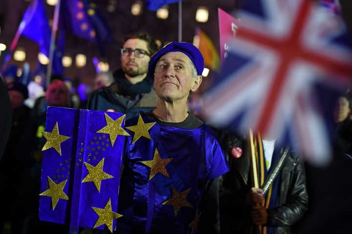 Anti-Brexit activists demonstrate with other protesters outside of the Houses of Parliament in central London on January 15, 2019.