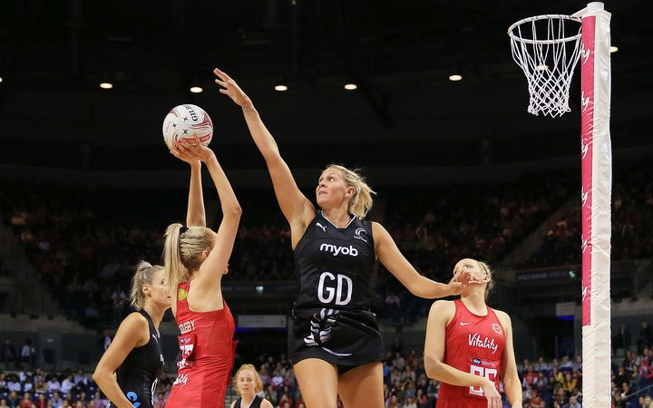 Helen Housby of England Roses lines up a shot challenged by Casey Kopua of New Zealand Silver Ferns