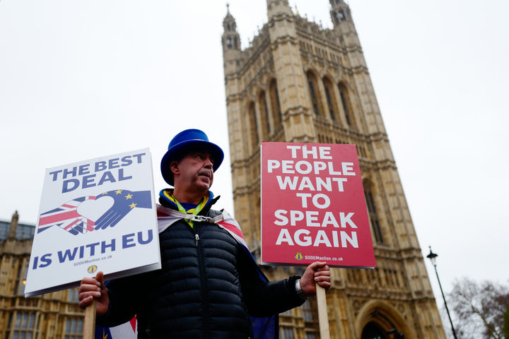 Anti-Brexit activist Steve Bray stands holding placards outside the Houses of Parliament in central London on January 16, 2019.