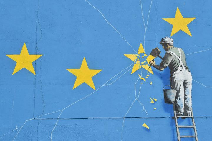 A mural by British artist Banksy depicting a workman chipping away at one of the stars on a European Union  themed flag. Dover, England, 7 January 2019.