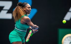 Serena Williams leans into a backhand at the Australian Open.