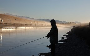Anglers on the Pukaki-Ohau A canal.