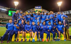 The victorious Indian cricket team with trophy