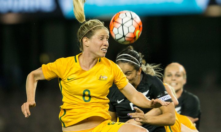 Australian Matildas player Elise Kellond-Knight goes up to head the ball against New Zealand.