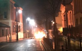 A handout picture taken and released by the Police Service of Northern Ireland on January 19, 2019 shows a burning car following a suspected car bomb in Londonderry, Northern Ireland
