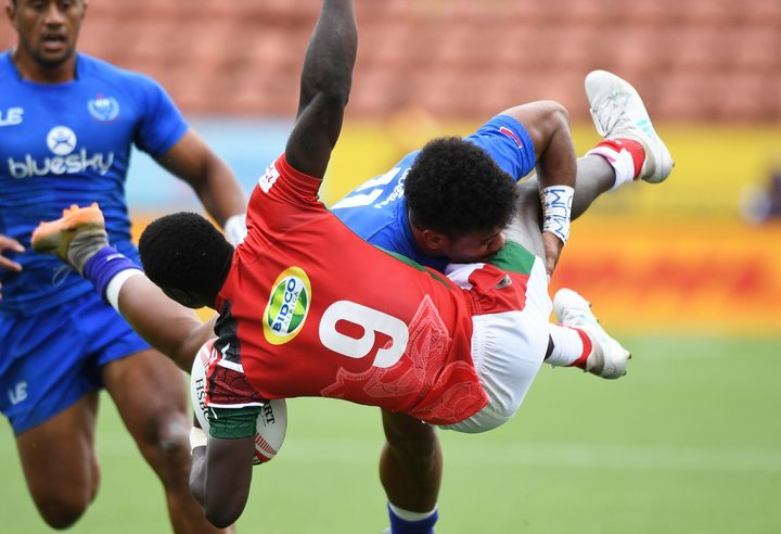 Samoa's Joe Perez tackles Kenya's Nelson Oyoo during the 2018 Hamilton Sevens.