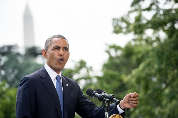 President Barack Obama takes a question as he makes a statement on the situation in Iraq on the South Lawn of the White House in Washington.