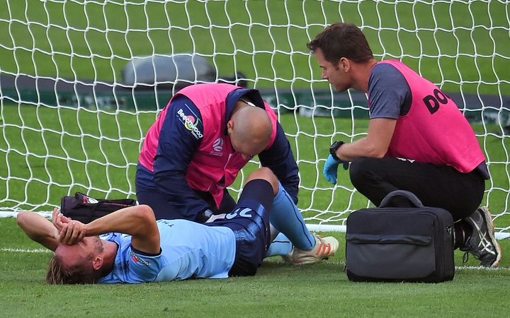 Sydney FC's Siem De Jong is treated by medical staff after scoring a goal.