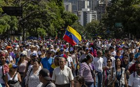 People march against the government of President Maduro.
