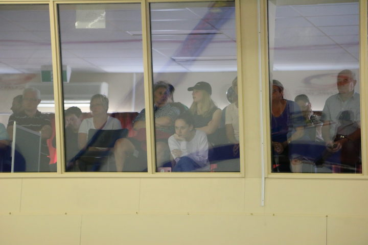 A crowd of Naseby locals watch from the spectators' lounge