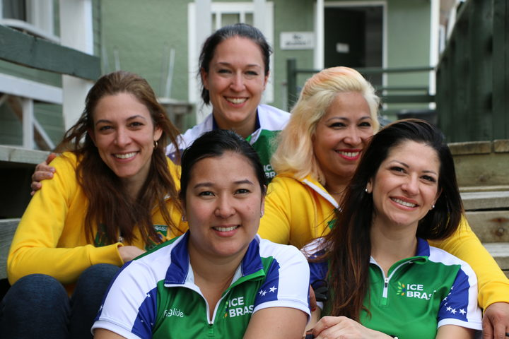 Brazil's women's team (L-R: Luciana Barrella, Anne Shibuya, coach Barbara Zbeetnoff, Alessandra Barros and Debora Monteiro) became interested in curling after seeing it during the 2010 Winter Olympics