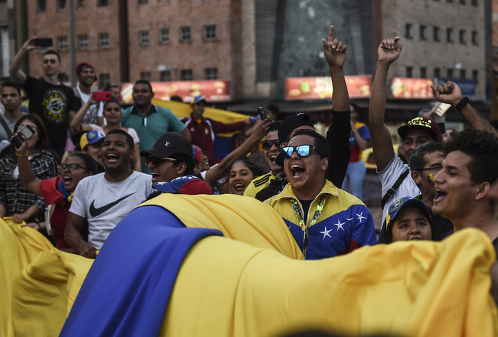 Venezuelans opposed to President Nicolas Maduro hold a demonstration in Medellin, Colombia in support of opposition leader Juan Guaido's self-proclamation as acting president of Venezuela, on January 23, 2019.