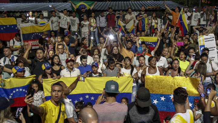 Venezuelans opposed to President Nicolas Maduro hold a demonstration in Sao Paulo, Brazil in support of opposition leader Juan Guaido's self-proclamation as acting president of Venezuela, on January 23, 2019.