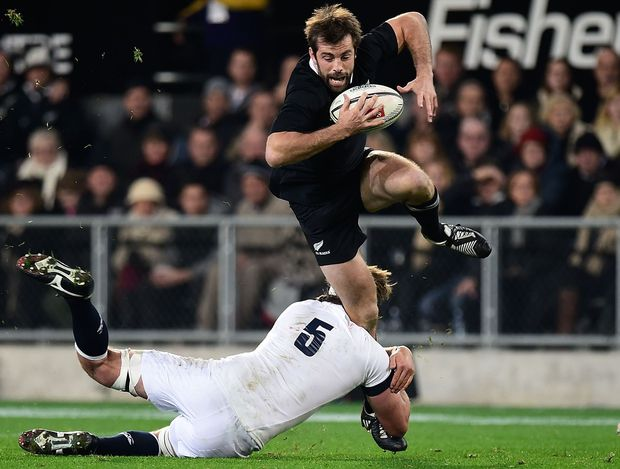 All Black Conrad Smith is tackled by England's Geoff Parling during the second  test match in Dunedin on June 14.
