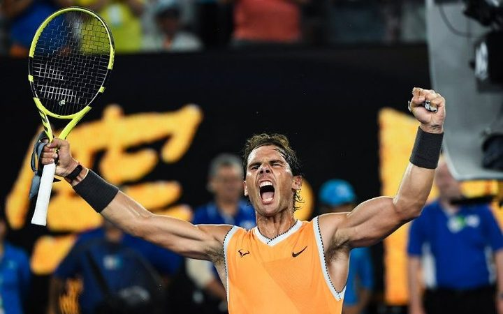 Spain's Rafael Nadal celebrates his victory against Greece's Stefanos Tsitsipas during their men's singles semi-final match on day 11 of the Australian Open tennis tournament in Melbourne on January 24, 2019