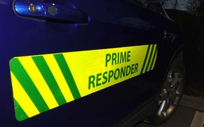Signs convert an ordinary car into a rural emergency response vehicle.
