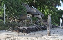 A seawall protecting a home from coastal erosion in Kiribati, climate change.
