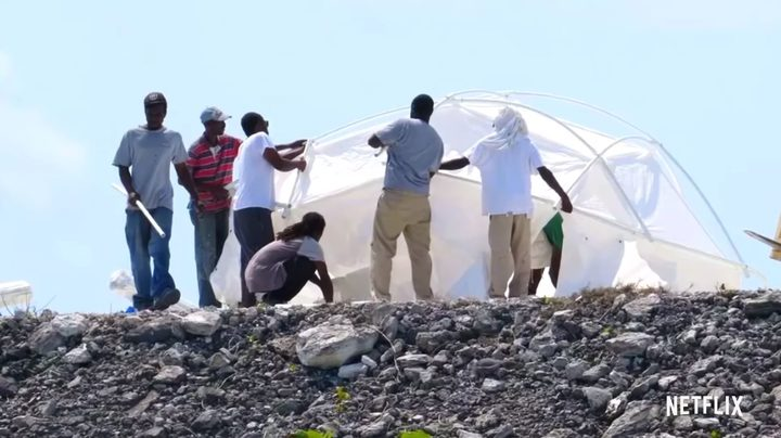 Workers erecting the 'luxury' tents at Fyre Festival (which turned out to be leftover hurricane tents)