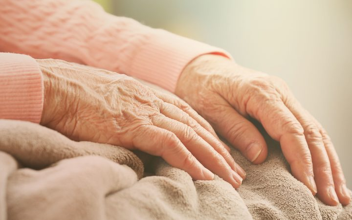 Old woman's hand, attention to the concept of the elderly